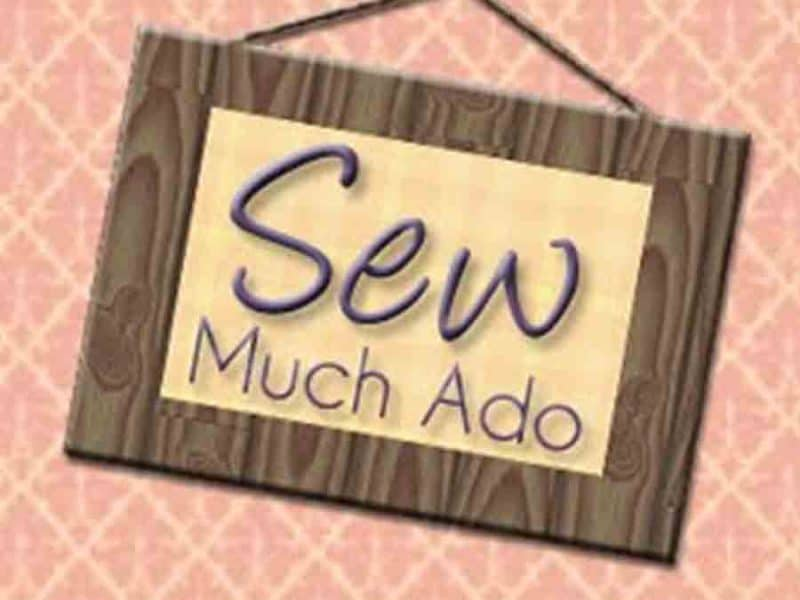 "Sign reading ""Sew Much Ado"""