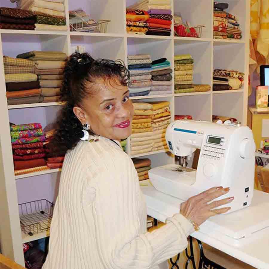 Lady at sewing machine