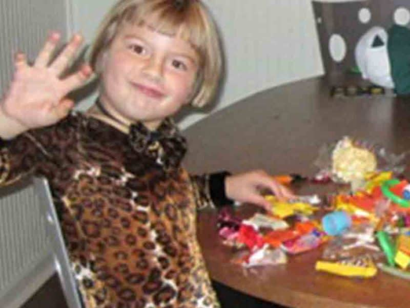 photo of little girl with Halloween candy