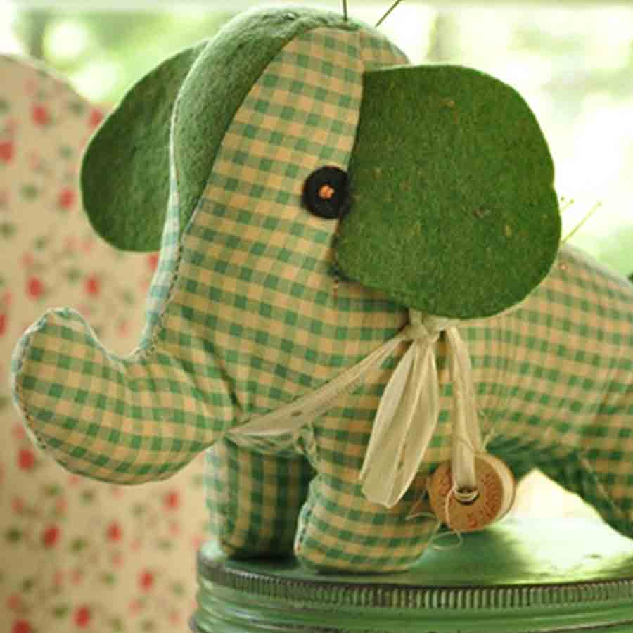 green gingham elephant toy