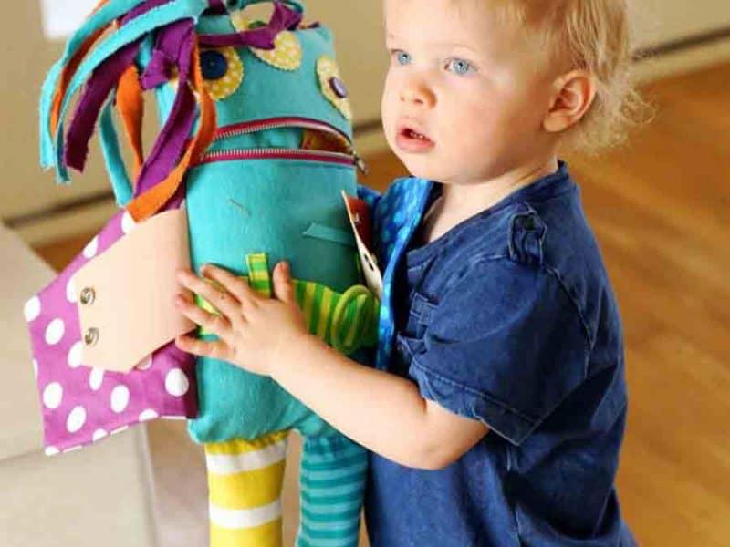 boy holding monster doll