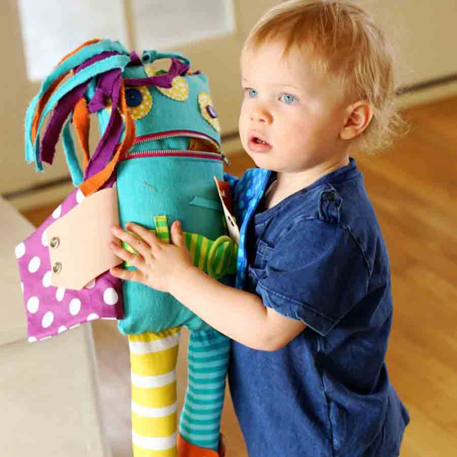 boy holding monster doll