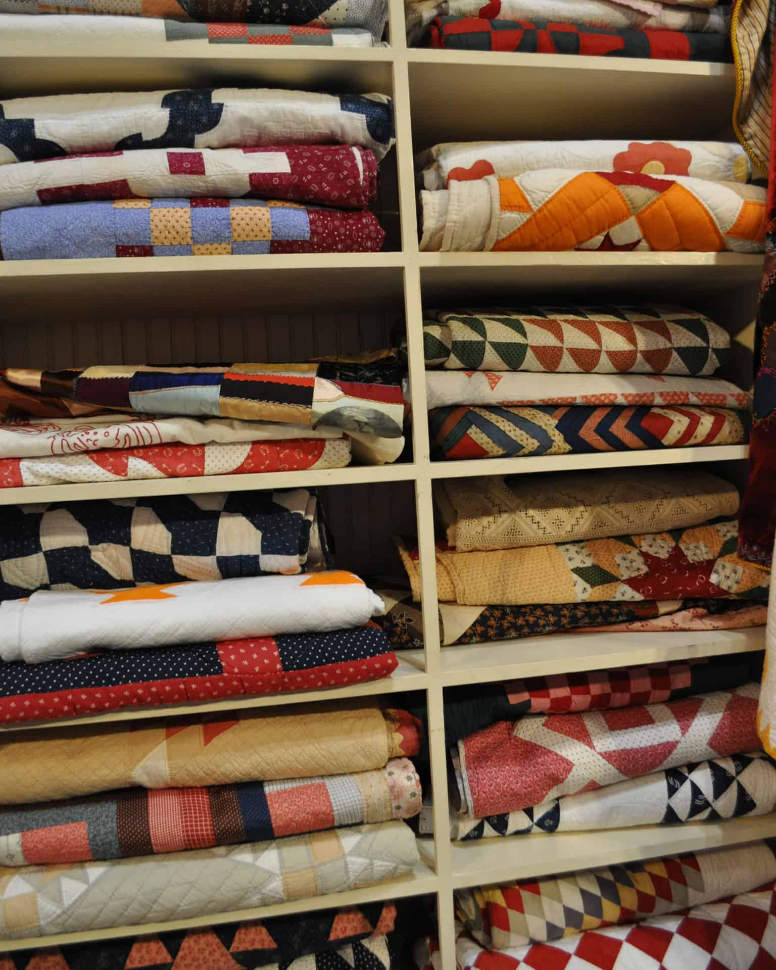 Shelves of quilts