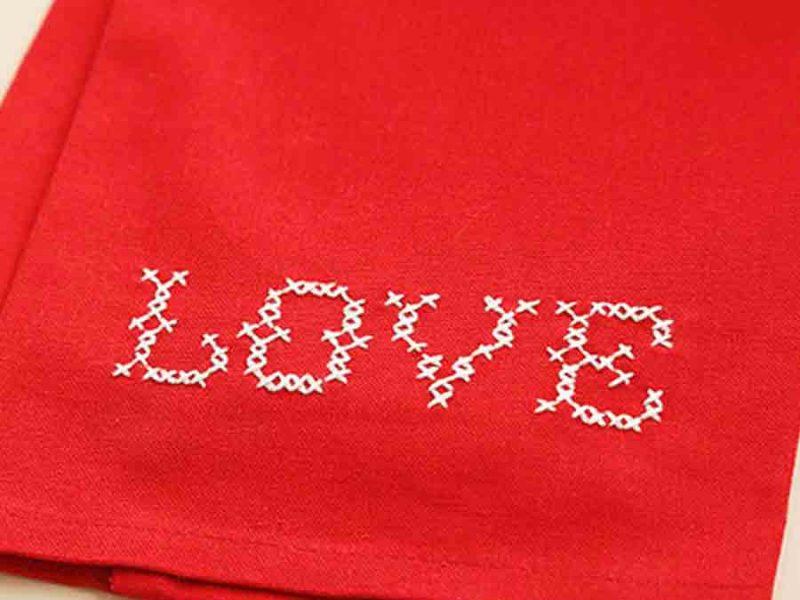 Love cross stitch on red towel