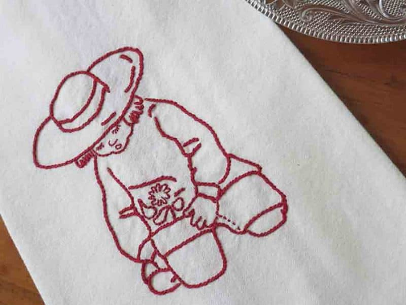 Redwork embroidery of boy with flower