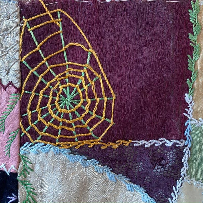 Spider web in crazy quilt